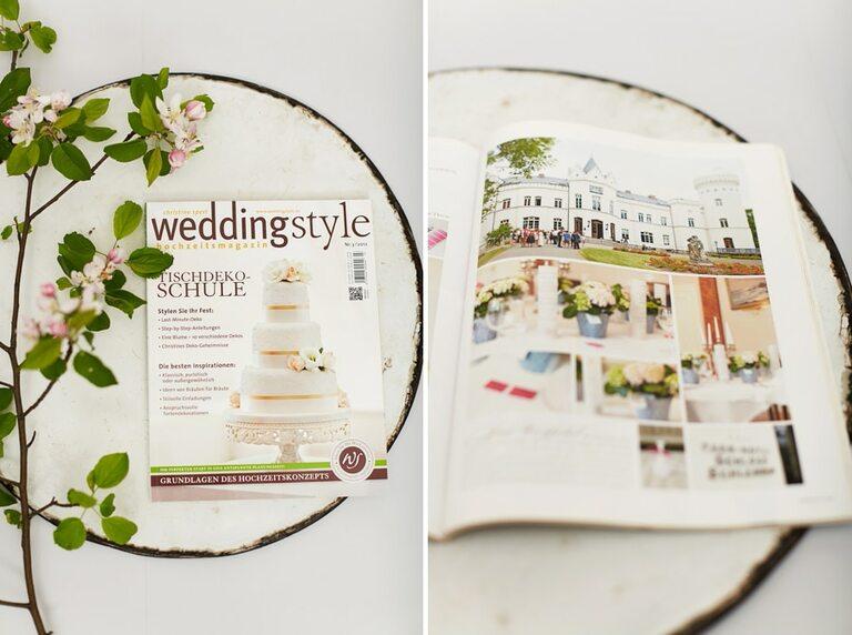 Das Hochzeitsmagazin Weddingstyle liegt auf einer weißen Metallplatte neben einem Zweig