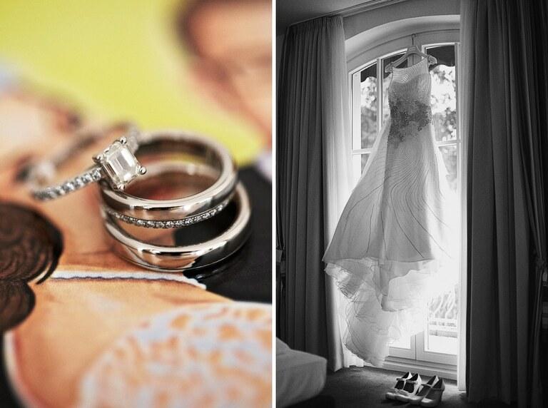 Ein Verlobungsring mit großen Stein liegt auf zwei Eheringen